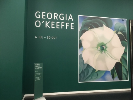 Georgia O'Keefe publicity poster showing white poppy painting