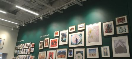 wall of O'Keefe paintings in the Tate Modern shop
