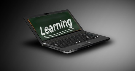 open laptop with the word learning on the screen