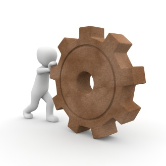 cartoon person pushing a brown cog wheel representing the gears of digital shifts