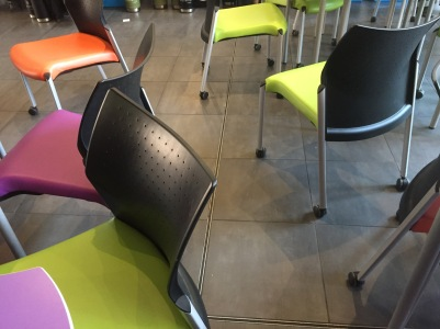 image of coloured plastic chairs on wheels