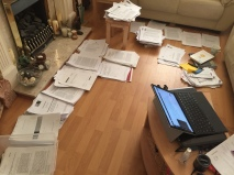 piles of paper across a floor