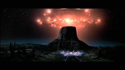image taken from the film close encounters of the third kind showing a spaceship over a mountain