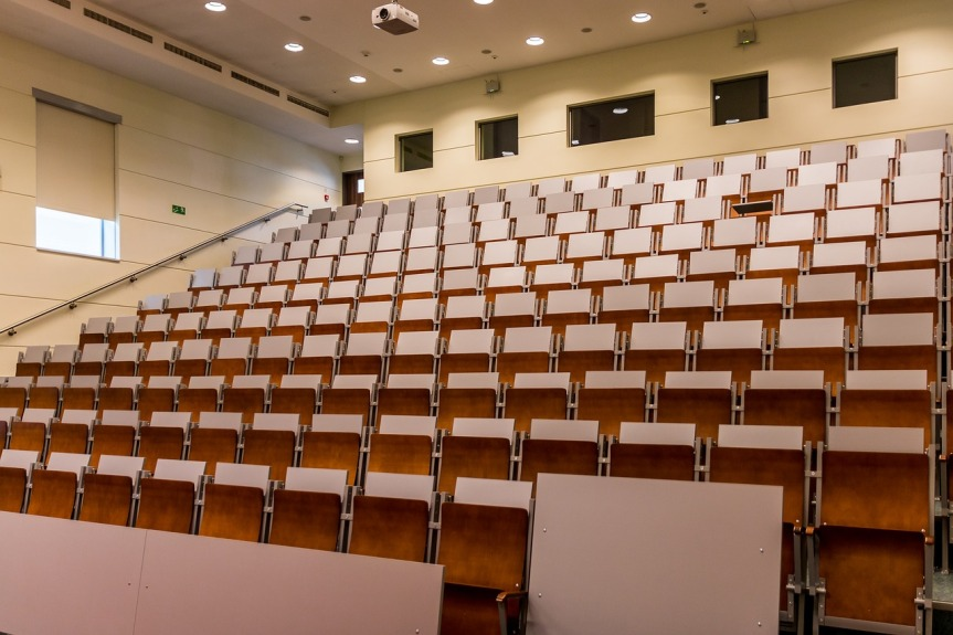 large empty lecture theatre with rows of empty seats