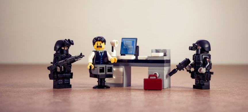 LEgo scene showing an armed police arrest