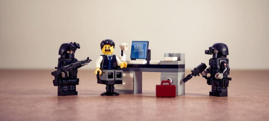 LEgo scene showing an armed police arrest