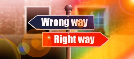 blue and red signs showing right way and wrong way
