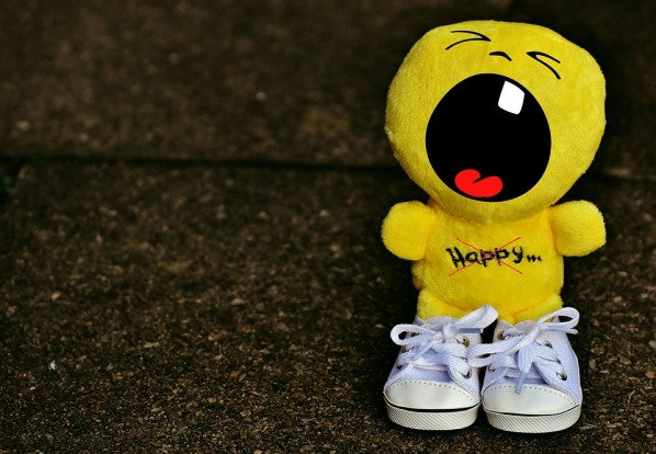 yellow soft toy with open mouth to scream