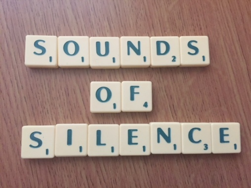 letter tiles spelling the words sounds of silence