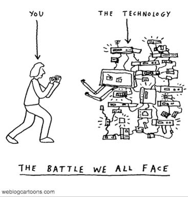cartoon showing a person facing angry technology with the caption The Battle we all Face