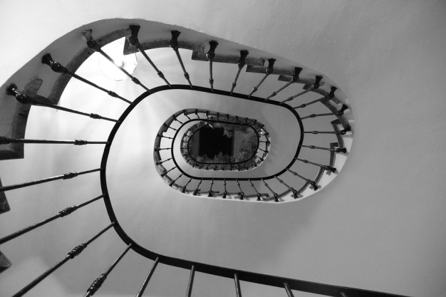 black and white image of soiral staircase