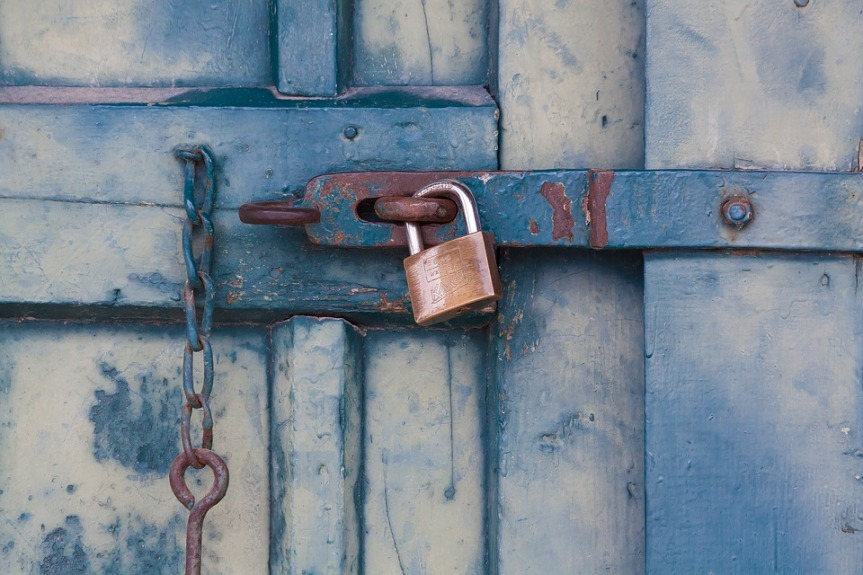 closed padlock on a shut dor