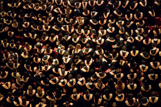 image showing a room full of graduates at a graduation ceremony