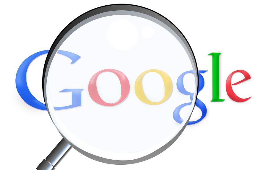 google icon seen through a magnifying glass