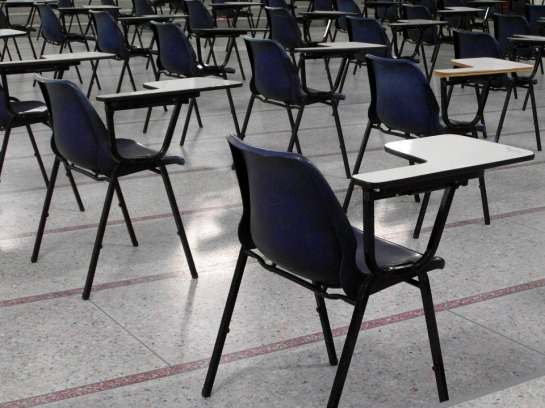 rows of empty desks and chairs