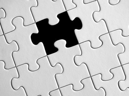 image shows a jigsaw with a missing piece