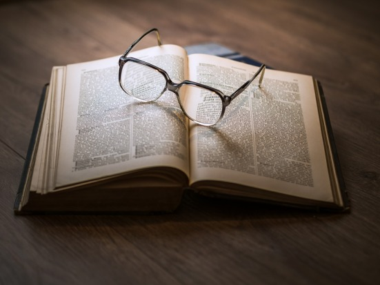 image showing an open book and pair of glasses