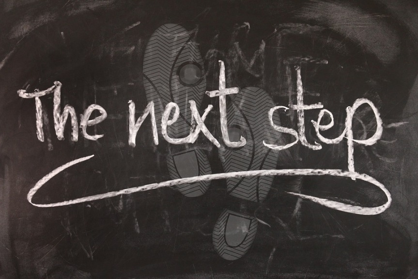 image showing the words 'the next step' chalked onto a blackboard