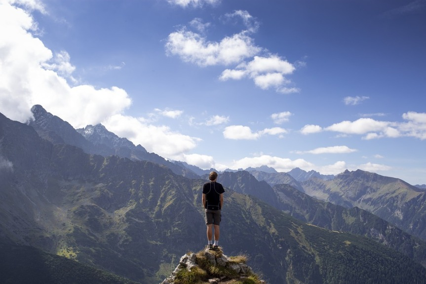image showing a person isolated on a mountain top