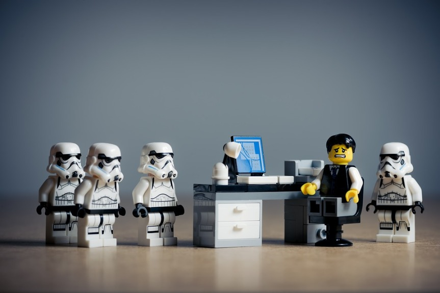 image showing lego figure sat at desk surrounded with lego stormtroopers, making him feel guilty
