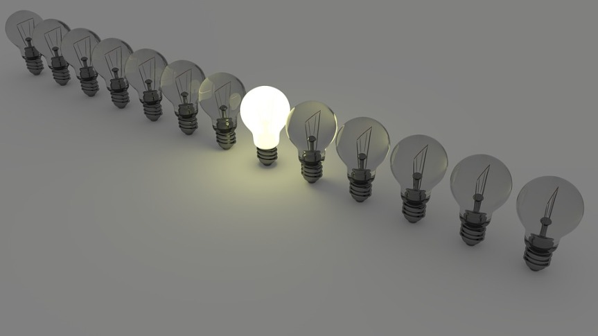 image showing a row of light bulbs with the centre one lit